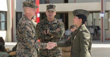 U.S. Marine Col. Jeffery Holt, commanding officer, School of Infantry - West, and Sgt. Maj. Jonathon Groth, School of Infantry - West sergeant major, greets Pvt. Nathalie Lizama, Camp Pendleton, Calif., March 6, 2018.