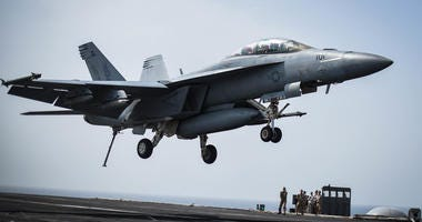 An F/A-18F Super Hornet prepares to land on the flight deck of the aircraft carrier USS Theodore Roosevelt (CVN 71) March 11, 2018.