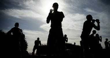 Recruits with Kilo Company, 3rd Recruit Training Battalion, participate in a Marine Corps Martial Arts training session
