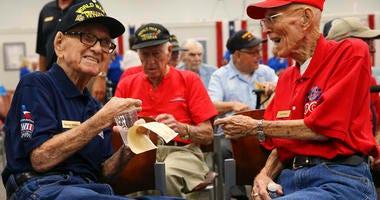 World War II veterans George Thomas, 97, left, and Clark Wilson, 93, enjoy conversation before a ceremony