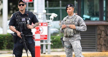 Security stands guard outside the main gate at Joint Base Pearl Harbor-Hickam