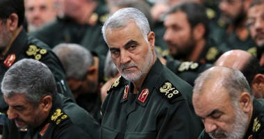 In this Sept. 18, 2016, file photo provided by an official website of the office of the Iranian supreme leader, Revolutionary Guard Gen. Qassem Soleimani, center, attends a meeting in Tehran, Iran.