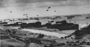 Barrage balloons protect dozens of ships on the Normandy beaches as they offload the men, material, and munitions needed to expand the beachhead.