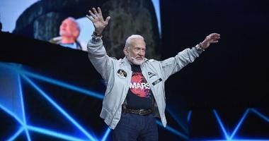 """Legendary astronaut Buzz Aldrin punches out a conspiracy theorist who called him a """"coward and a liar."""""""