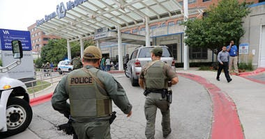 Police officers enter Jesse Brown VA Medical Center after reports of possible shots fired inside the hospital on Monday, Aug. 12, 2019 in Chicago.