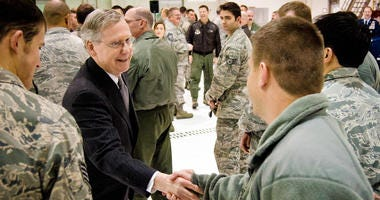 Sen. Mitch McConnell greets members of the 123rd Airlift Wing