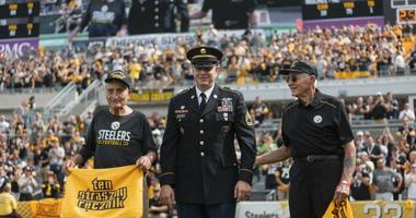 "Theodore ""Ted"" Sikora, left, and Edward ""Ed"" Sikora, right. are honored by the Pittsburgh Steelers"