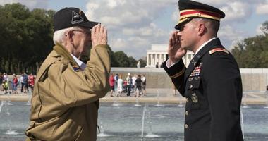 Army Maj. Peter Semanoff salutes World War II veteran Clarence Smoyer