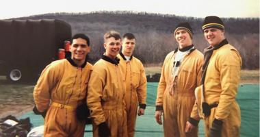 Col. Drew Morgan, center, a member of USMA Class of 1998, is pictured during his time as a member of the West Point Parachute Team