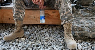 U.S. Army Spc. William Lang, 25, from Dallas, Texas, assigned to the Kapisa-Parwan Provincial Reconstruction Team, smokes a cigarette while waiting to go out on mission from Bagram Airfield, Afghanistan on Aug. 9.