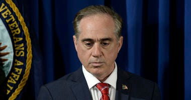 Secretary of Veterans Affairs David Shulkin listens to President Trump before signing an Executive Order on Improving Accountability and Whistleblower Protection at the Department of Veterans Affairs in Washington, DC, April 27, 2017.