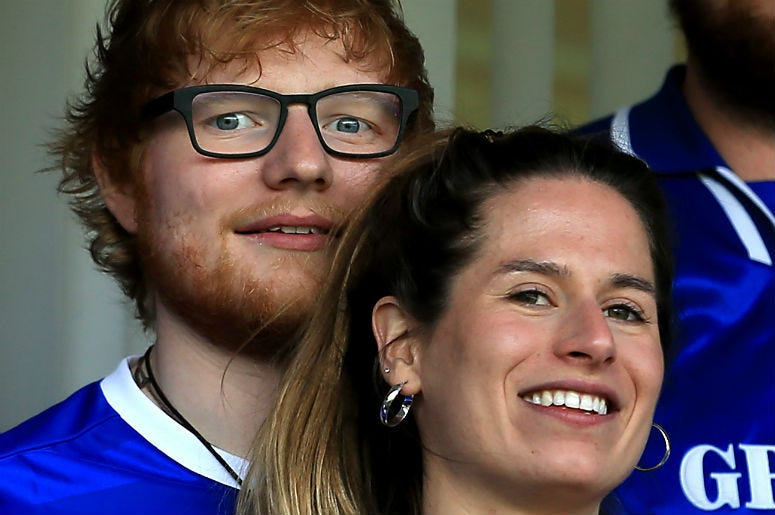 Musician Ed Sheeran and fiance Cherry Seaborn look on during soccer game in Ipswich, England.