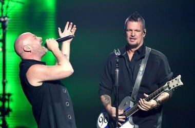 Singer David Draiman (L) and guitarist Dan Donegan of Disturbed perform