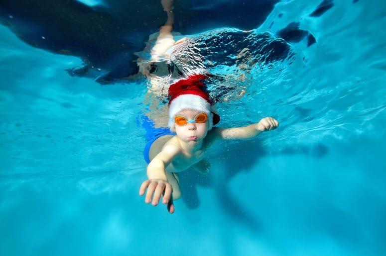 Kid Swimming in Santa Hat