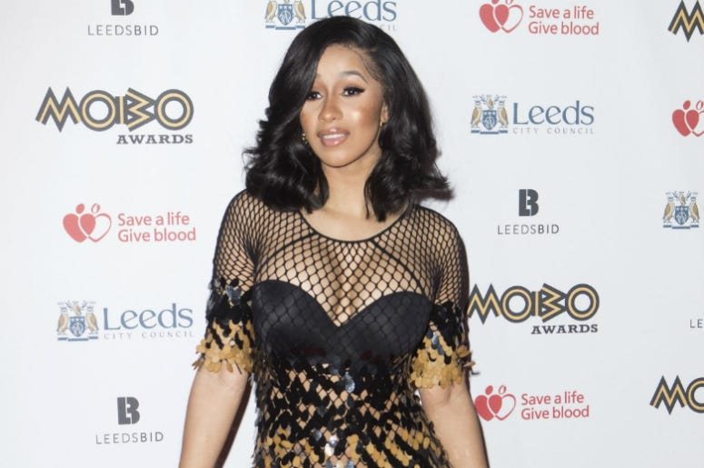 """4/26/2018 - File photo dated 29/11/17 of Cardi B, who has reassured fans she will still be working her """"ass off"""" despite cancelling a number of live shows due to her pregnancy."""