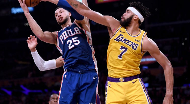 Photo of Javale McGee trying to block Ben Simmons' shot.