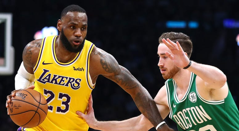 Photo of a Boston player guarding a Los Angeles player.