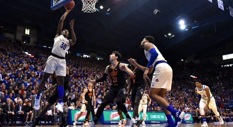 Photo of Kansas player attempting a layup.