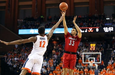Photo of a Virginia player contesting a Louisville player's shot.