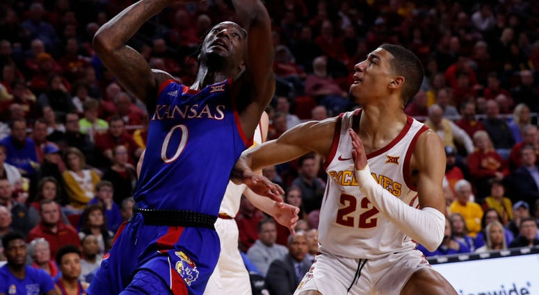 Photo of a Kansas player going up for a dunk.