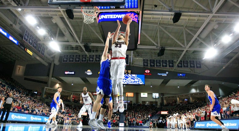 Photo of a BYU player contesting a Gonzaga player's layup.