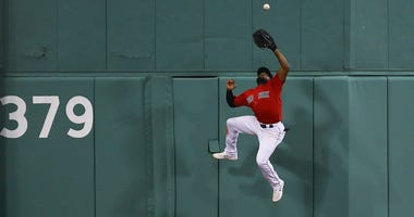 Jackie Bradley Jr. and Yadier Molina weren't happy about their Gold Glove snubs