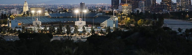 Baseball players union calls on swanky hotel to rehire laid-off workers