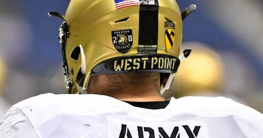 Army coach dazed after head-butt with player wearing helmet