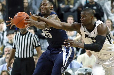 photo of a Providence and Villanova players fighting for the ball.