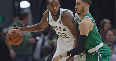 Photo of a Celtics player defending the Bucks player.