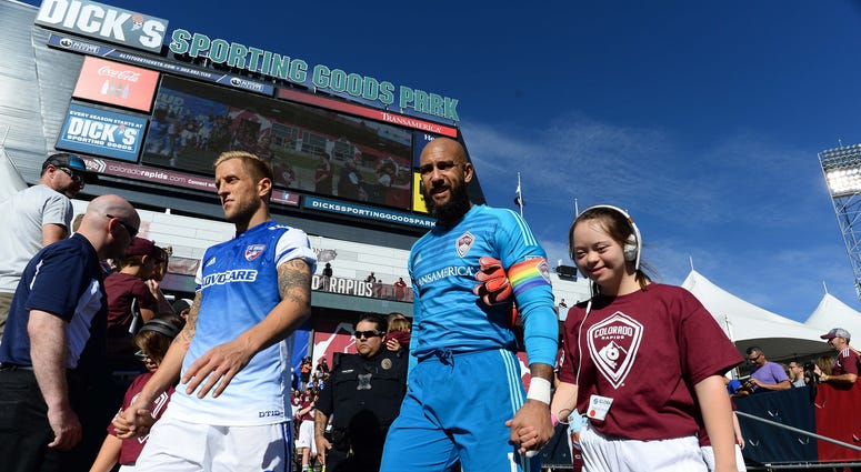 FC Dallas defender Reto Ziegler (3) and Colorado Rapids goalkeeper Tim Howard (1) walk out to the pitch before the match at Dicks Sporting Goods Park.