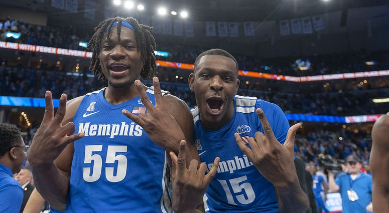 Feb 22, 2020; Memphis, Tennessee, USA; Memphis Tigers forward Precious Achiuwa (55) and forward Lance Thomas (15) celebrate after the game against the Houston Cougars at FedExForum.