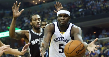 Memphis Grizzlies forward Zach Randolph (50) reaches for a loose ball as San Antonio Spurs forward Kawhi Leonard (2) defends during the first quarter in game six of the first round of the 2017 NBA Playoffs at FedExForum.