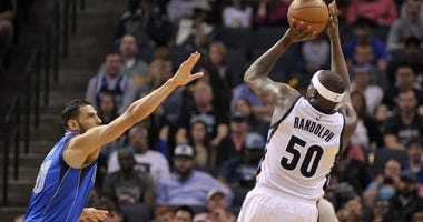 Memphis Grizzlies forward Zach Randolph (50) shoots over Dallas Mavericks center Salah Mejri (50) during the second half at FedExForum. Memphis Grizzlies defeated the Dallas Mavericks 99-90.