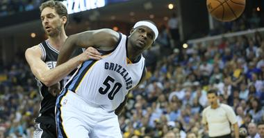 Memphis Grizzlies forward Zach Randolph (50) looks toward a loose ball as he is held by San Antonio Spurs forward Pau Gasol (16) in game six of the first round of the 2017 NBA Playoffs at FedExForum.