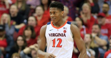 De'Andre Hunter of Virginia celebrates during a game.