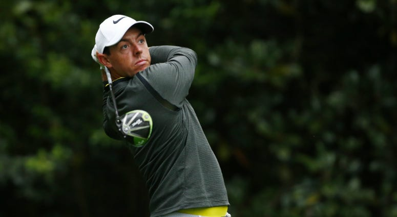 Rory McIlroy hits a tee shot on the 11th hole during a practice round at Augusta National GC.