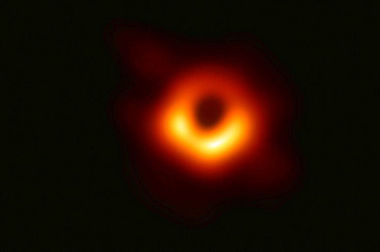 This image released Wednesday, April 10, 2019, by Event Horizon Telescope shows a black hole. Scientists revealed the first image ever made of a black hole after assembling data gathered by a network of radio telescopes around the world. (Event Horizon Te