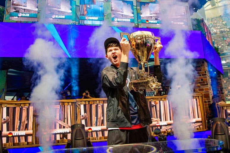 """In this Sunday, July 28, 2019 photo provided by Epic games, Kyle Giersdorf reacts after he won the Fortnite World Cup solo finals in New York. Giersdorf, of Pottsgrove, Pa. who goes by the name """"Bugha"""" when competing, racked up the most points and won $3"""