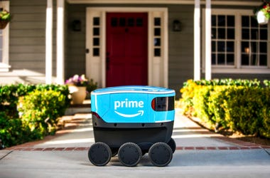 This undated photo provided by Amazon shows a self-driving delivery robot that Amazon is calling Scout. Amazon is expanding the use of its self-driving delivery robots to a second state. The online shopping giant says the six-wheeled robots, about the siz