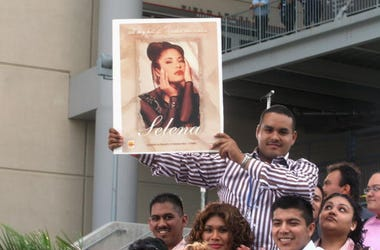 Fans of Selena and Latin music wait at the 'Selena Vive' tribute concert, April 7, 2005, Reliant Stadium, Houston, Texas. Many of the stars of Latin music and television came to pay their respects and honor the memory of the pop star. (Photo by Jana Birch