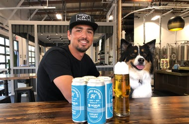 Harland Head Brewer Ryan Alvarez and Koda share a Harland Export Lager