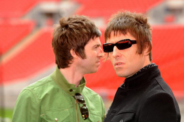 File photo dated 16/10/2008 of Noel (left) and Liam Gallagher who ays his brother Noel is desperate to get Oasis back together but has been thwarted by his wife.