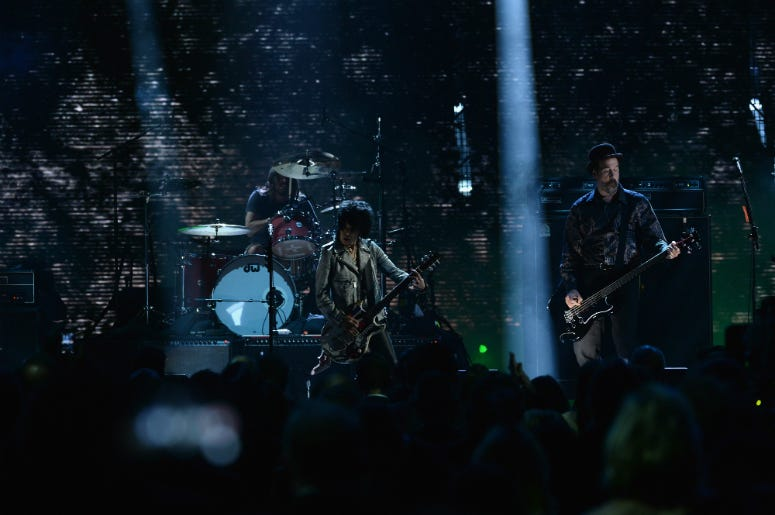 Joan Jett (C) performs with Dave Grohl and Krist Novoselic of Nirvana