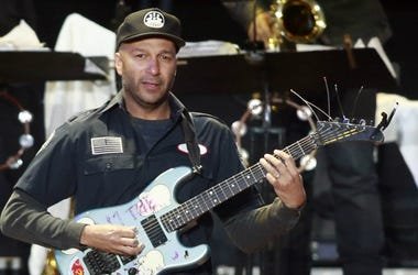 Tom Morello plays guitar during the March Madness Music Festival with Bruce Springsteen (not pictured) and the E Street Band at Reunion Park.