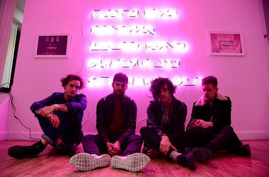 "George Daniel, Ross MacDonald, Matthew Healy and Adam Hann of The 1975 appear during the The 1975 album release pop-up for ""I Like It When You Sleep, For You Are So Beautiful Yet So Unaware Of It"" on February 25, 2016 in New York City. (Photo by Theo Warg"