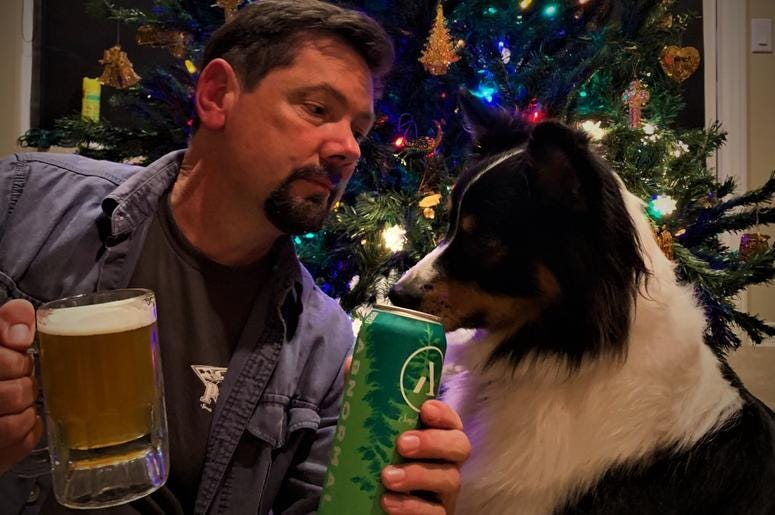 Ken tries to decide if Koda is going to be naughty or nice as his pup eyes a can of Pine Bomb IPA