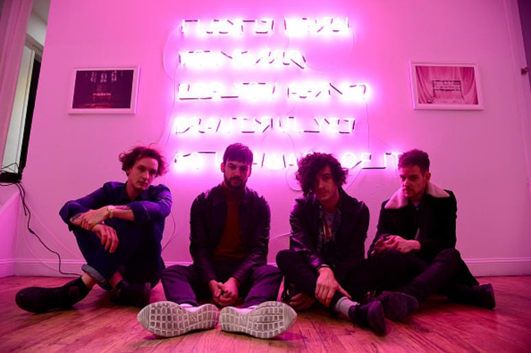"""George Daniel, Ross MacDonald, Matthew Healy and Adam Hann of The 1975 appear during the The 1975 album release pop-up for """"I Like It When You Sleep, For You Are So Beautiful Yet So Unaware Of It"""" on February 25, 2016 in New York City. (Photo by Theo Warg"""