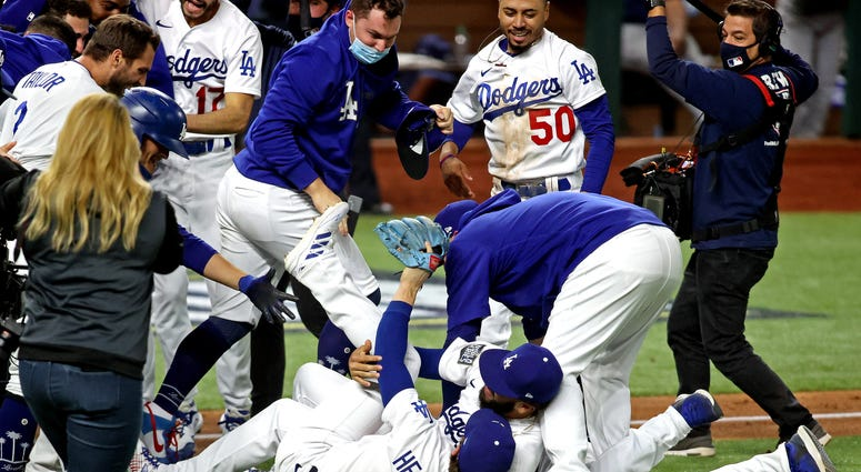 LAD WS 2020 Champs dogpile