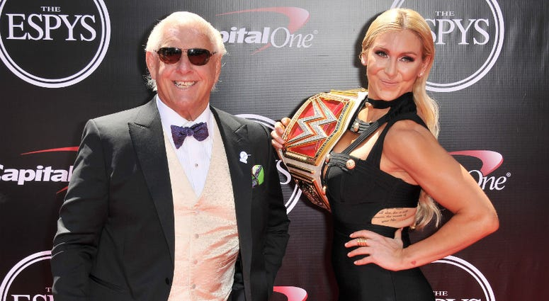 Ric Flair and WWE Diva Charlotte arrives at The 2016 ESPYS held at the Microsoft Theater in Los Angeles, CA on Wednesday, July 13, 2016.